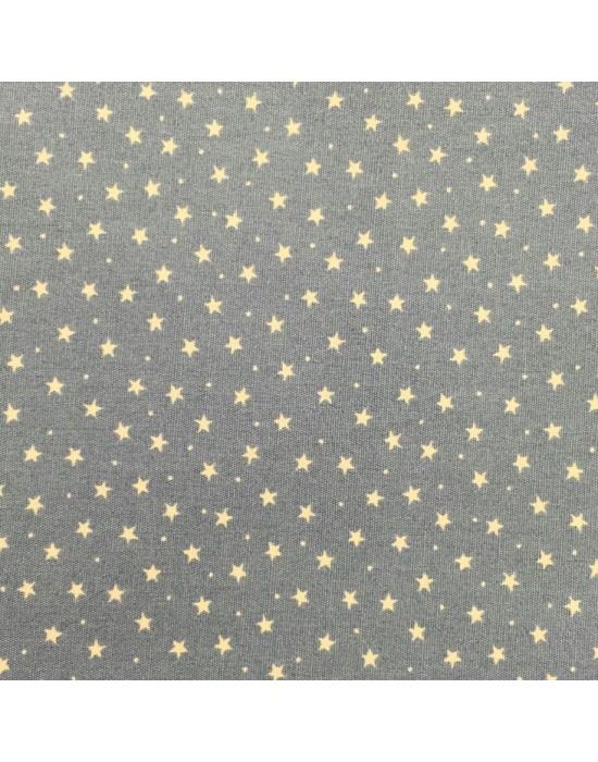 Tela patchwork estrellas beige sobre fondo verde