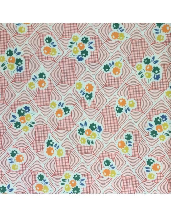 Tela patchwork flores de colores sobre fondo rayado naranja